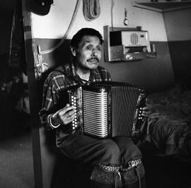 Photograph of Jimmy Koneak playing the accordion in Fort Chimo, Quebec