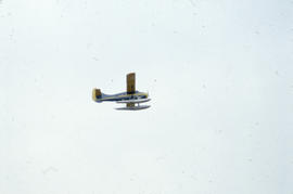 Photograph of an RCMP airplane in flight
