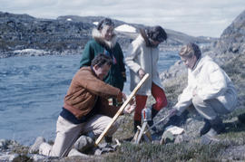Photograph of Barbara Hinds and three other people with a kettle in Frobisher Bay, Northwest Terr...