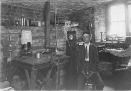 Photograph of Prof. H.A. Bumstead in his room making vacuum to split atoms and A.S. MacKenzie mea...