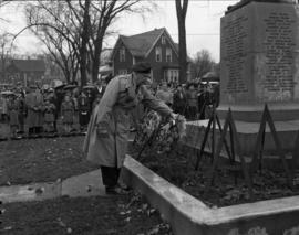 Veteran laying wreath at Remembrance Day ceremony at World War One Cenotaph in Carmichael Park, N...