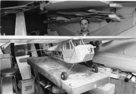 Photograph of Ken Beaver with model airplane