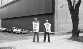 Photograph of two members of CUPE 1392 on strike