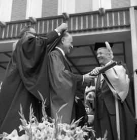 Photograph of Dr. Leonard A. Miller receiving an honorary degree