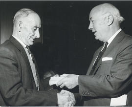 Photograph of Dr. Henry D. Hicks presenting a gift to A. Sampson