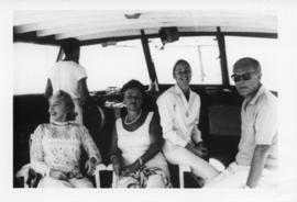 Photograph of Dorothy Johnston Killam on a boat with several unidentified people