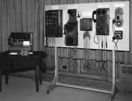 Photograph of early telephone switchboards and intercommunication telephones used in warehouses a...