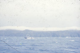 Photograph of a schooner in heavy weather off the coast of Newfoundland and Labrador
