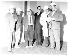 Photograph of six unidentified men in the Student Union Building