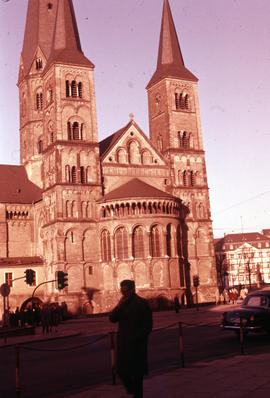 Photograph of the Bonn Minster with unidentified man in front
