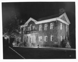 Photograph of the MacDonald Memorial Library at night