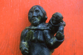 Photograph of a stone sculpture of a woman and child from Cape Dorset, Northwest Territories