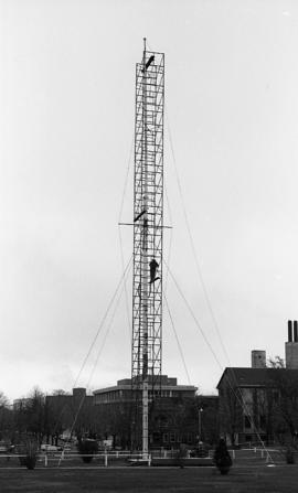 Photograph of a flag pole being repaired