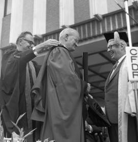 Photograph of Dr. Gordon B. Wiswell receiving an honorary degree
