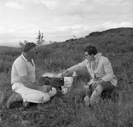 Photograph of a man and a woman having a picnic in Dawson City, Yukon