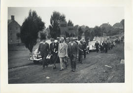 Photograph of a procession at an alumni reunion