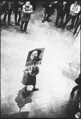 Photograph of a Maoist student, protesting alone in the foyer of the Dalhousie Student Union Buil...