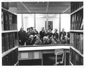 Photograph of an audience at the dedication of the Sir James Dunn Law Library
