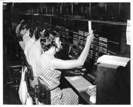 Photograph of operators removing tickets in Sydney