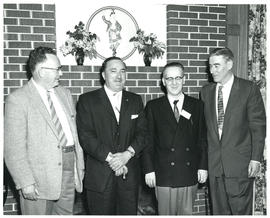Photograph of four people at miscellaneous unknown health-related event
